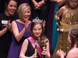 Maddie Lorenzen, a senior speech-language pathology major, crowns a queen at the Iowa Miss Amazing Pageant.