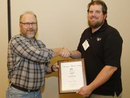 Mark Pegg, fisheries ecologist with the School of Natural Resources, accepts the Nebraska Chapter of the American Fisheries Society Award of Excellence.