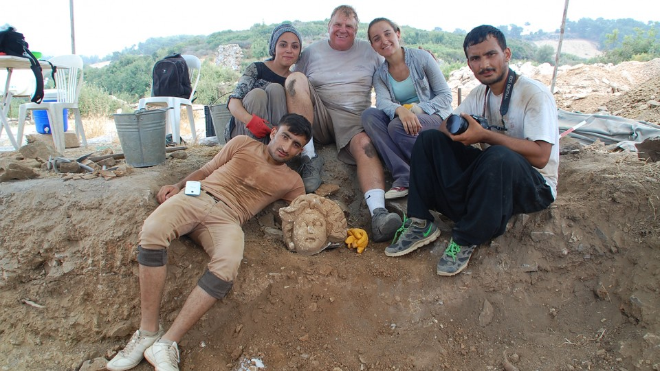 Michael Hoff (center), Hixson-Lied professor of art history at the University of Nebraska-Lincoln, with Turkish students who found a Medusa's head at the Antiochia ad Cragum archaeological site in Turkey in 2015.