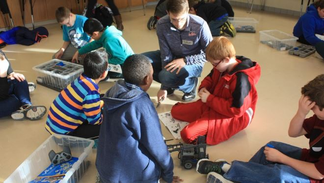 Nebraska student Colton Harper mentors students at Culler Middle School as part of a robotics club formed in January.