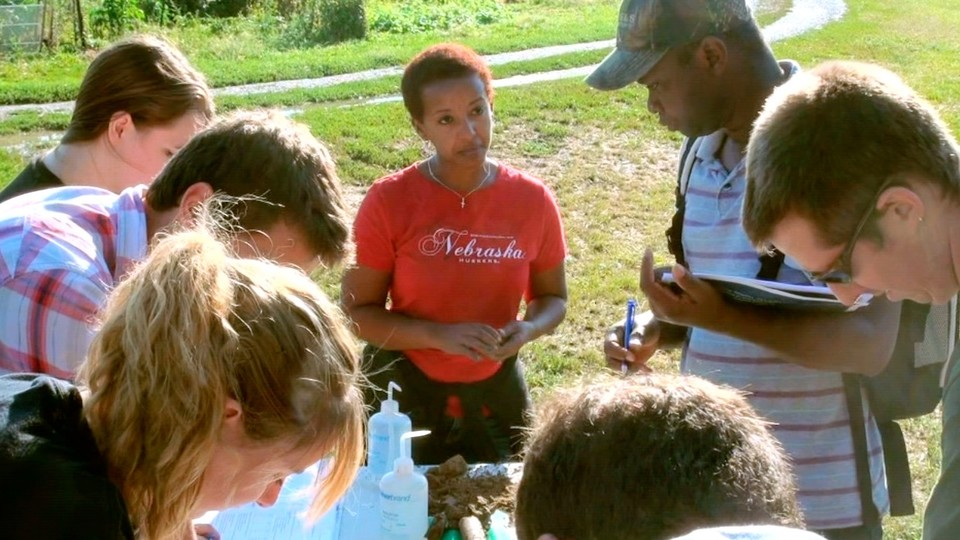 Martha Mamo, Weaver Professor of Agronomy and Horticulture, works with Nebraska students.   Dave Fitzgibbon, University Communication