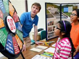 Claudia Carrillo (center) and Paula Carrillo (right) learn about drought from Jake Petr, a meteorology student in the Dept of Earth and Atmospheric Sciences, during the 16th annual Weatherfest in April 2016 at Hardin Hall. The 2017 event is April 1 at the