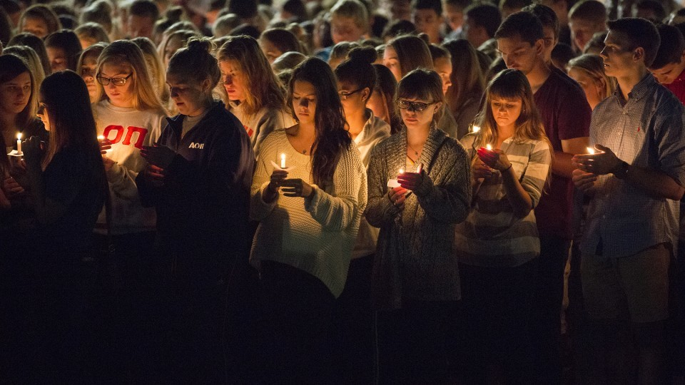 Students participate in a candlelight vigil honoring UNL students Keaton Klein and Clayton Real in 2014. The university will honor students who died during the current academic year on April 7.   University Communications file photo