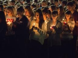 Students participate in a candlelight vigil honoring UNL students Keaton Klein and Clayton Real in 2014. The university will honor students who died during the current academic year on April 7. | University Communications file photo