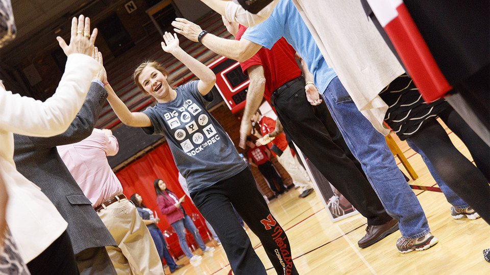 Katelyn Bendorf, an FFA member and University of Nebraska-Lincoln commit, receives high-fives during the signing ceremony April 6 at the Coliseum. | Craig Chandler, University Communications