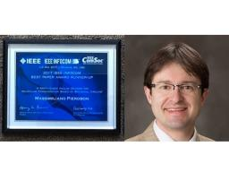 Dr. Massimiliano Pierobon and his award.