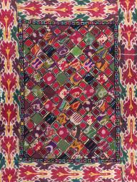 "This patchwork wall hanging made in Uzbekistan circa 1870-1880 is one of dozens of pieces featured in ""Sacred Scraps: Quilt and Patchwork Traditions of Central Asia,"" which is now showing at the International Quilt Study Center & Museum."