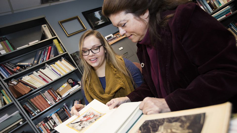 Student Amzie Dunekacke (left) works with Laura White, Weaver Professor of English at Nebraska, on a UCARE project in 2016. Eighty-eight Nebraska students have earned stipends to participate in research with faculty members this summer. | University Commu