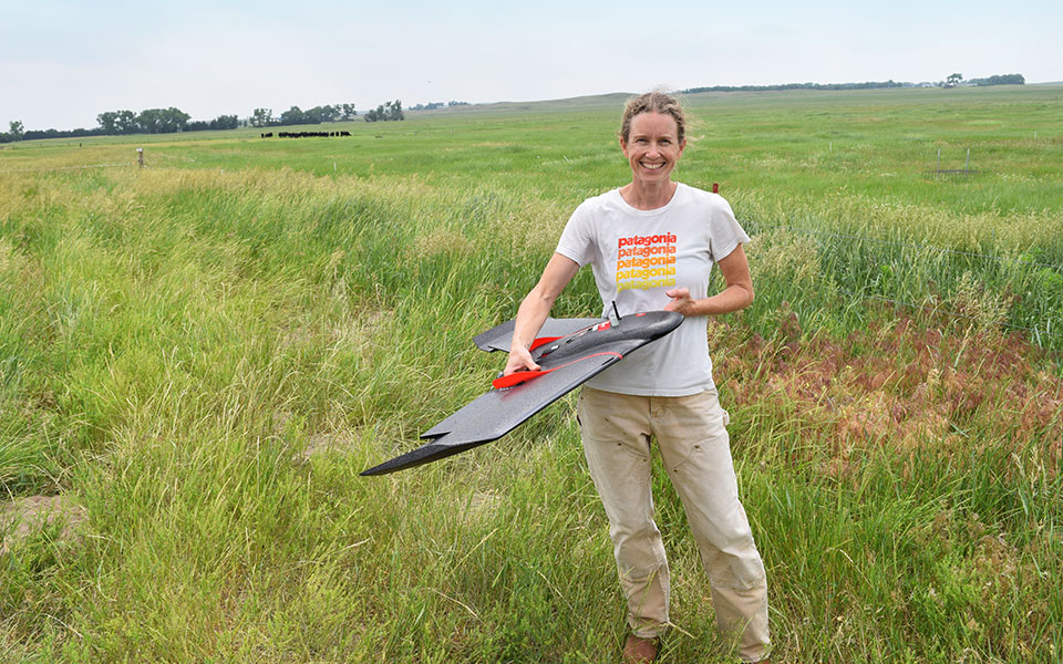 University of Nebraska–Lincoln graduate student Amanda Sanford gets ready to release an eBee SQ agricultural drone at the Barta Brothers Ranch near Ainsworth, Nebraska.