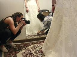 Alanna Johnson photographs May Nguyen as she works on a customer's wedding dress in her shop, May's Alterations.