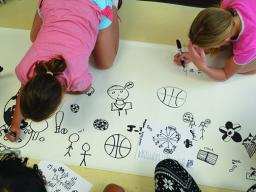 "Students from Culler Middle School's Community Learning Center draw symbols as part of the ""Me+We"" Summer Design Workshop. Courtesy photo."