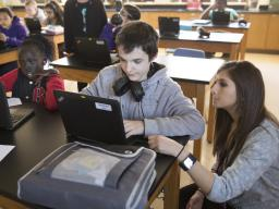 University Communications  |  In this file photo, Noyce Scholar Sarah Al-shdifat teaches science at Goodrich Middle School. A new Nebraska study found that middle-school boys who believed males are innately better at science also were less likely to say t