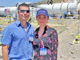 Alexandra Dominguez and her husband, Dave, stand in front of a booster rocket at the Orbital ATK test facility in Promontory, Utah. The Dominguezes attended a ground test of the Space Launch System's five-segment solid rocket motor on June 28, 2016.
