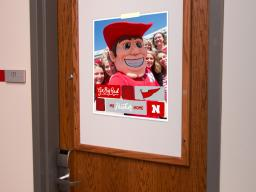Sample Welcome Selfie sign hanging on a residence hall door.