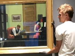 "Sheldon employees install ""Room in New York"" by Edward Hopper. The iconic artwork is featured in the museum's new exhibition, ""Sheldon Treasures.""  Courtesy photo."