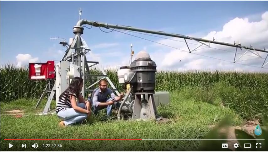 Isabella Possignolo and Sandeep Bhatti demonstrate the use of irrigation equipment on YouTube.