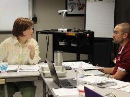 Jessica Thompson (left) teaches Math 807T in Hastings in June 2017.
