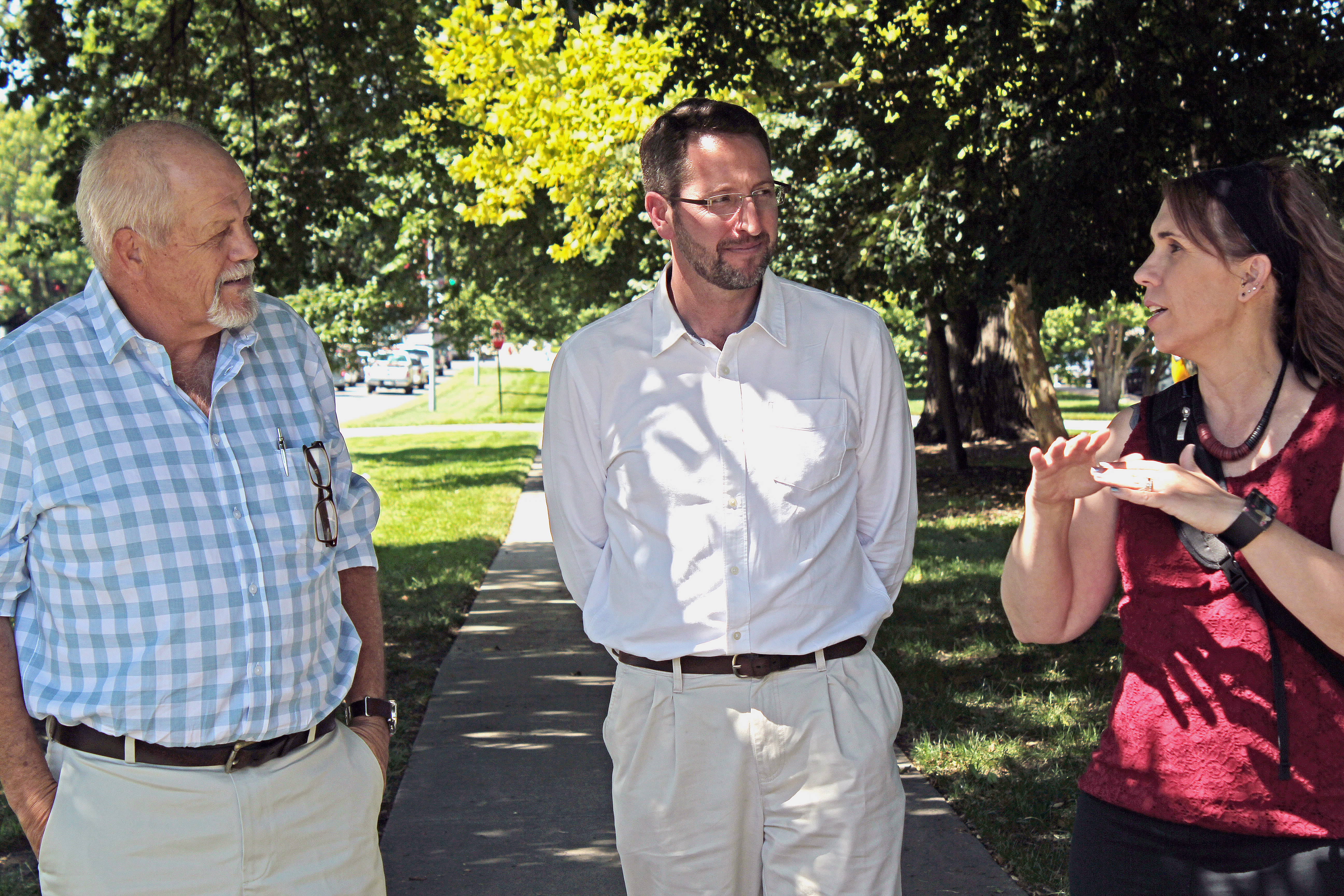 Andries Jordaan, left, and Janse Robie, both of disaster management agencies in South Africa, talk with NDMC climatologist Deborah Bathke during a recent visit to learn about the center's available tools. | NDMC