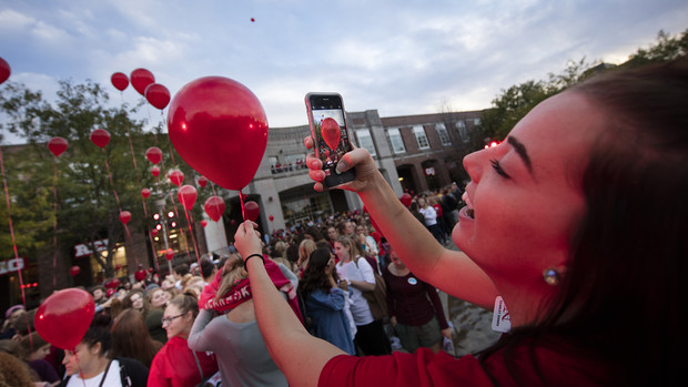 Kylie Gunderson photographs her balloon before the release during the 2016 homecoming pep rally. | Craig Chandler, University Communication