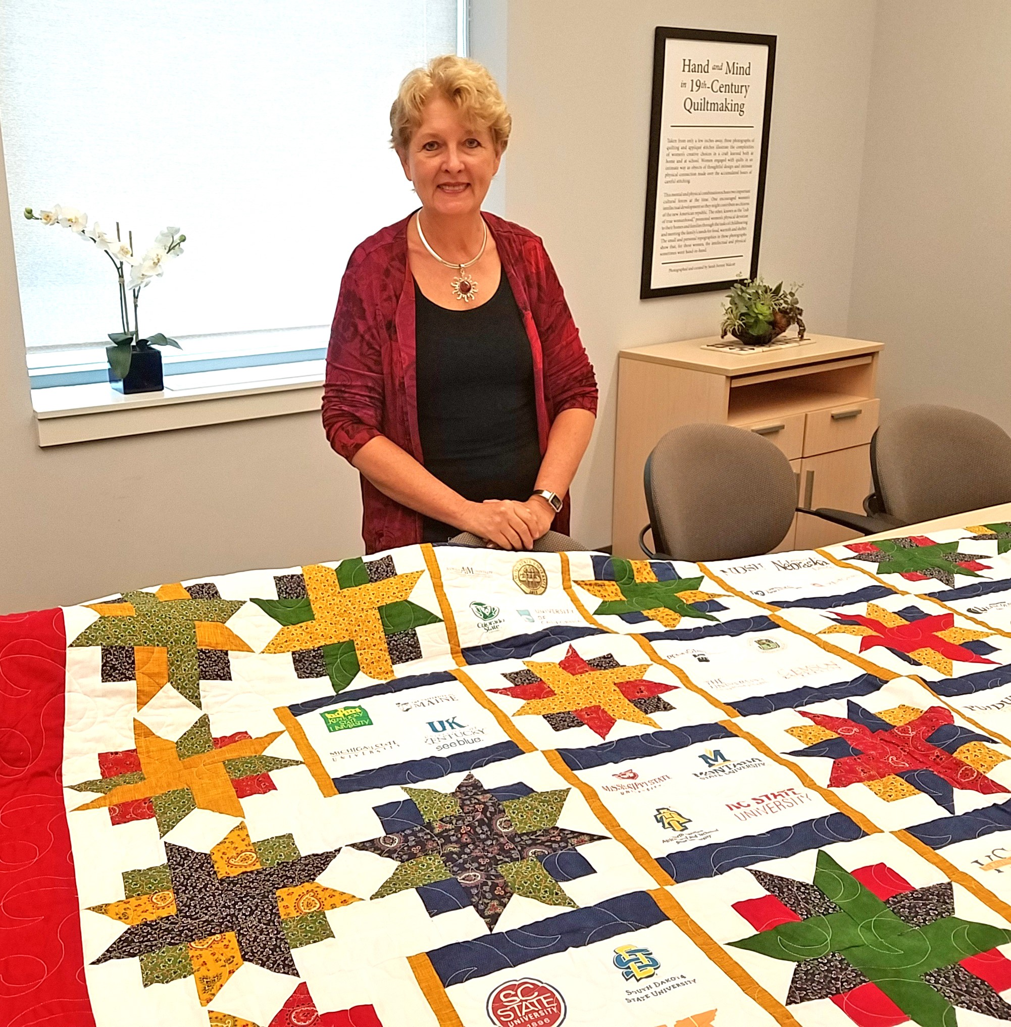Dr. Jane Schuchardt with the quilt made in her honor by Dr. Michelle Rodgers of the University of Delaware Extension.