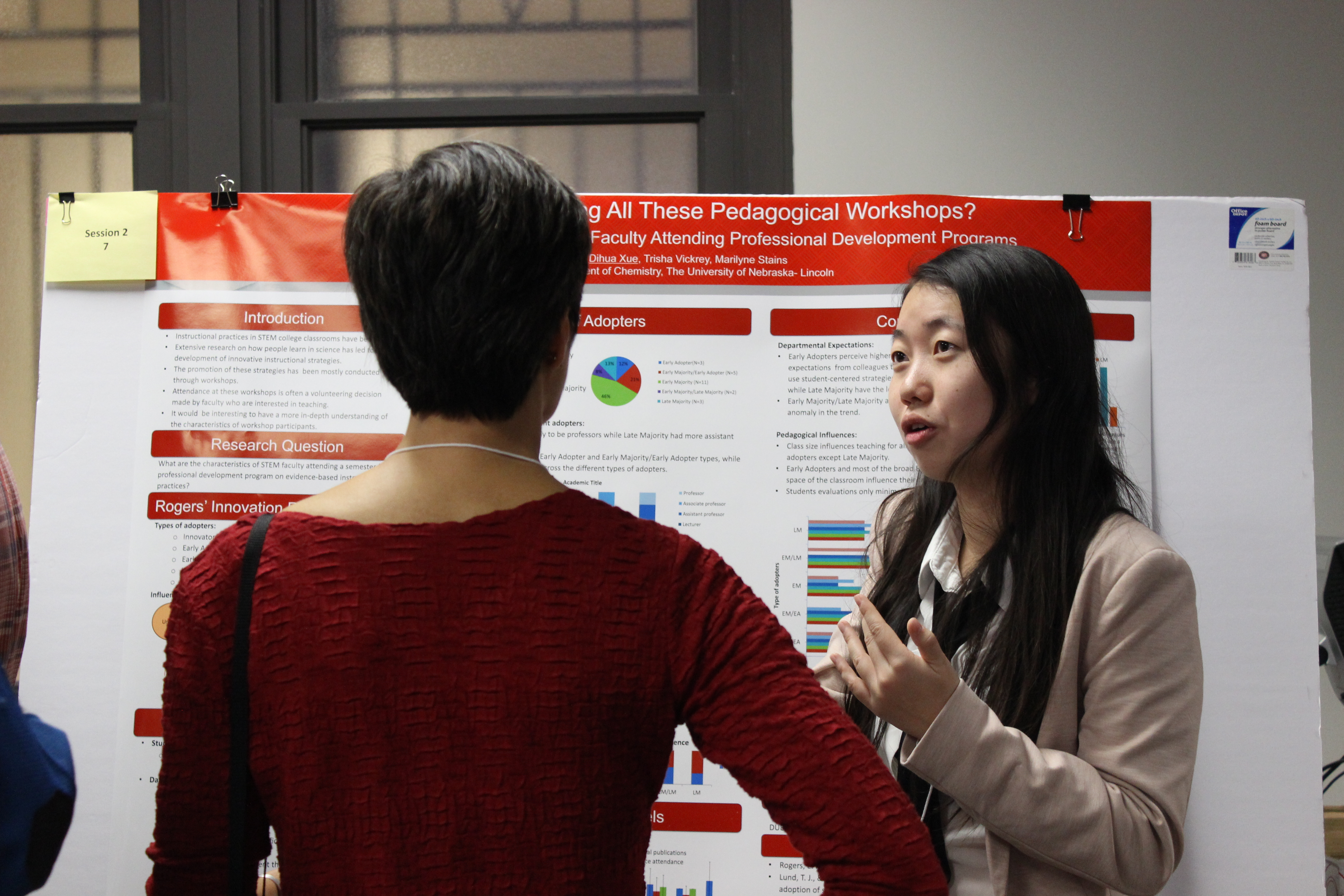 Dihua Xue (graduate student in chemical education) shares the results of her project with Amy Spiegel (research associate professor in Educational Psychology) at the 2015 retreat.