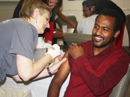 A Nebraska Medicine – University Health Center nurse gives a student an influenza vaccine during a 2016 flu shot clinic.