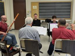 """The Moran Woodwind Quintet rehearse for their Nov. 15 concert, which features the premiere of Scott McAllister's """"OK Quintet."""" Photo by Michael Reinmiller."""
