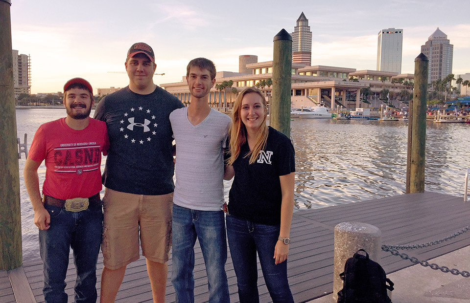 Rodger Farr (from left), Shawn McDonald, Kolby Grint and Samantha Teten stand in front of the Tampa Convention Center during the ASA-CSSA-SSSA 2017 Annual Meeting.