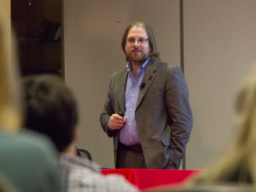 Gus Hurwitz,  assistant professor and co-director of the Space, Cyber & Telecom Law Program at the UNL College of Law, discusses the different between public and private information. (Photo by Emily Case).