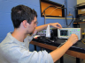 UNL electrical engineering student Thomas Fink observes the signal from an optical sensor.