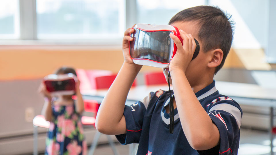 A Nebraska team led by Changmin Yan, associate professor of advertising and public relations, has created a virtual reality game that teaches kindergarten children about nutrition and physical activity.