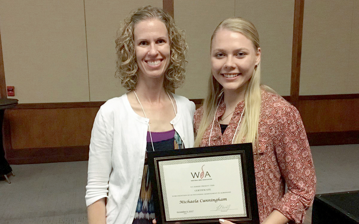 Leah Sandall, agronomy distance education coordinator, left, with Michaela Cunningham at the WSA awards ceremony.