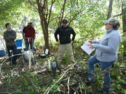 DWFI Faculty Fellow Karrie Weber (right), associate professor of biological sciences and earth and atmospheric sciences at Nebraska, provides direction to doctoral student Jeffrey Westrop (second from right), Nebraska Water Center post-doctoral research a