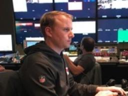 Kevin Brebner, director of production for the Kansas City Chiefs, works in the control room directing the postgame show.