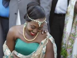 Bride Isabella Katwesigye smiles while listening to her family speak during her traditional wedding ceremony. In addition to covering this story, Tess Williams had various opportunities to immerse herself in the rich culture of Uganda. Photo by Tess Willi