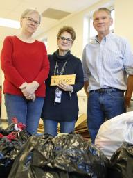 From left, Dee Ebbeka, School of Natural Resources Community Engagement member; Linda Kern, Clinton Elementary faculty care coordinator; and John Carroll, director of SNR at the University of Nebraska-Lincoln, pose with this year's Coats for Clinton donat
