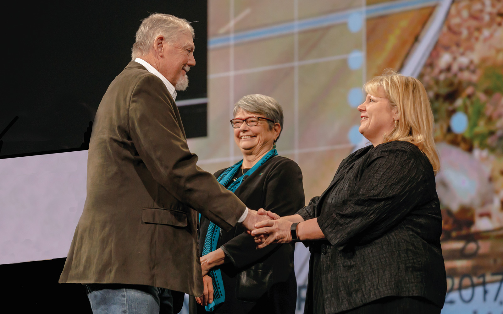 Richard Sutton (left) receives the ASLA Research Honor Award at the ASLA Annual Meeting and EXPO in Los Angeles Oct. 23 from Vaughn B. Rinner and Elizabeth Miller.  | Photo courtesy of ASLA / EPNAC