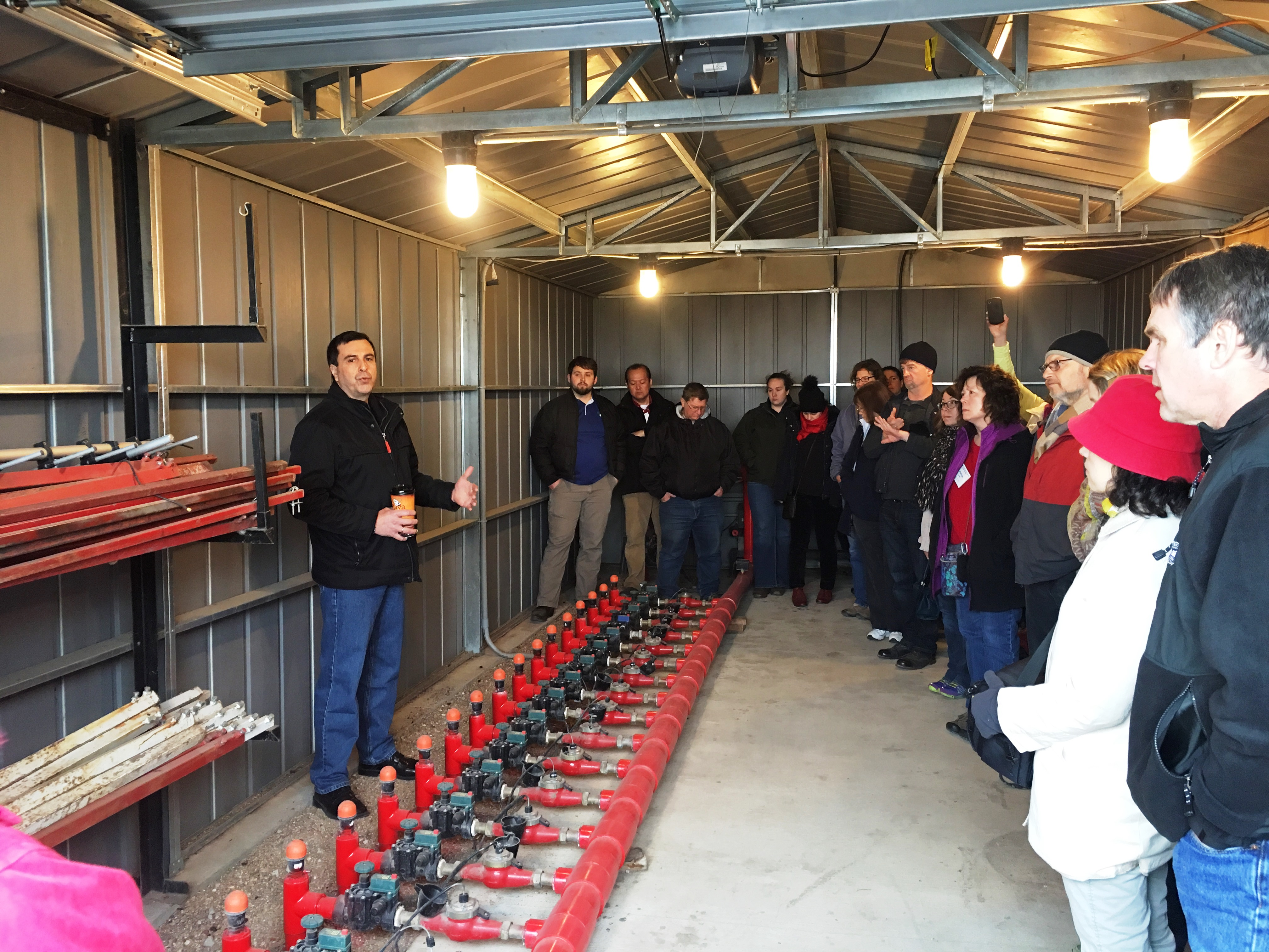 Professor Suat Irmak instructs others on the use of microirrigation technology as part of his award-winning research.