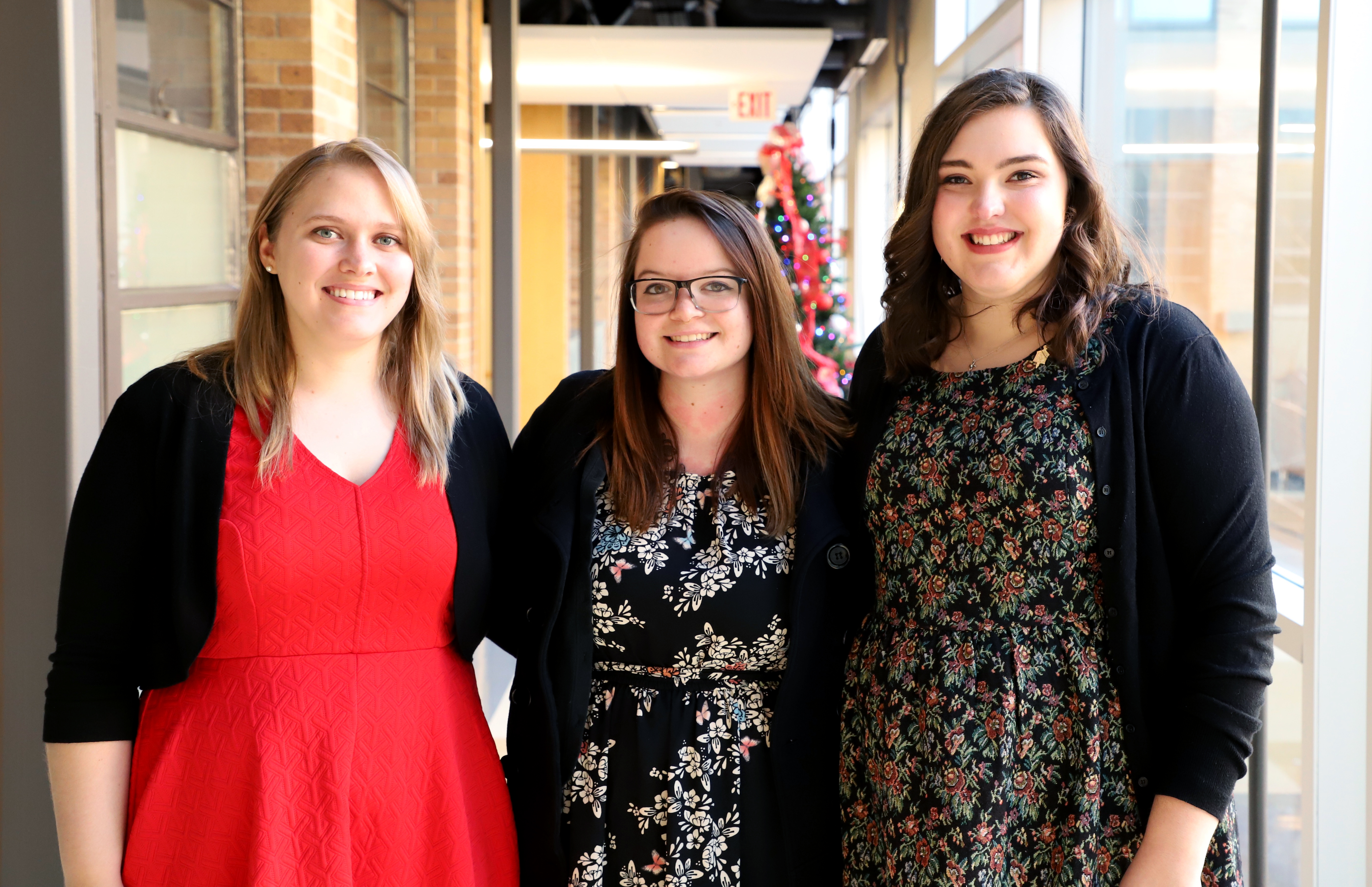 Callie Meyer, from left, Anna Yost and Elizabeth Lutz celebrate at the department undergraduate graduation reception with family, friends, faculty and staff.