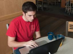 Student studies at Abel Dining Hall.