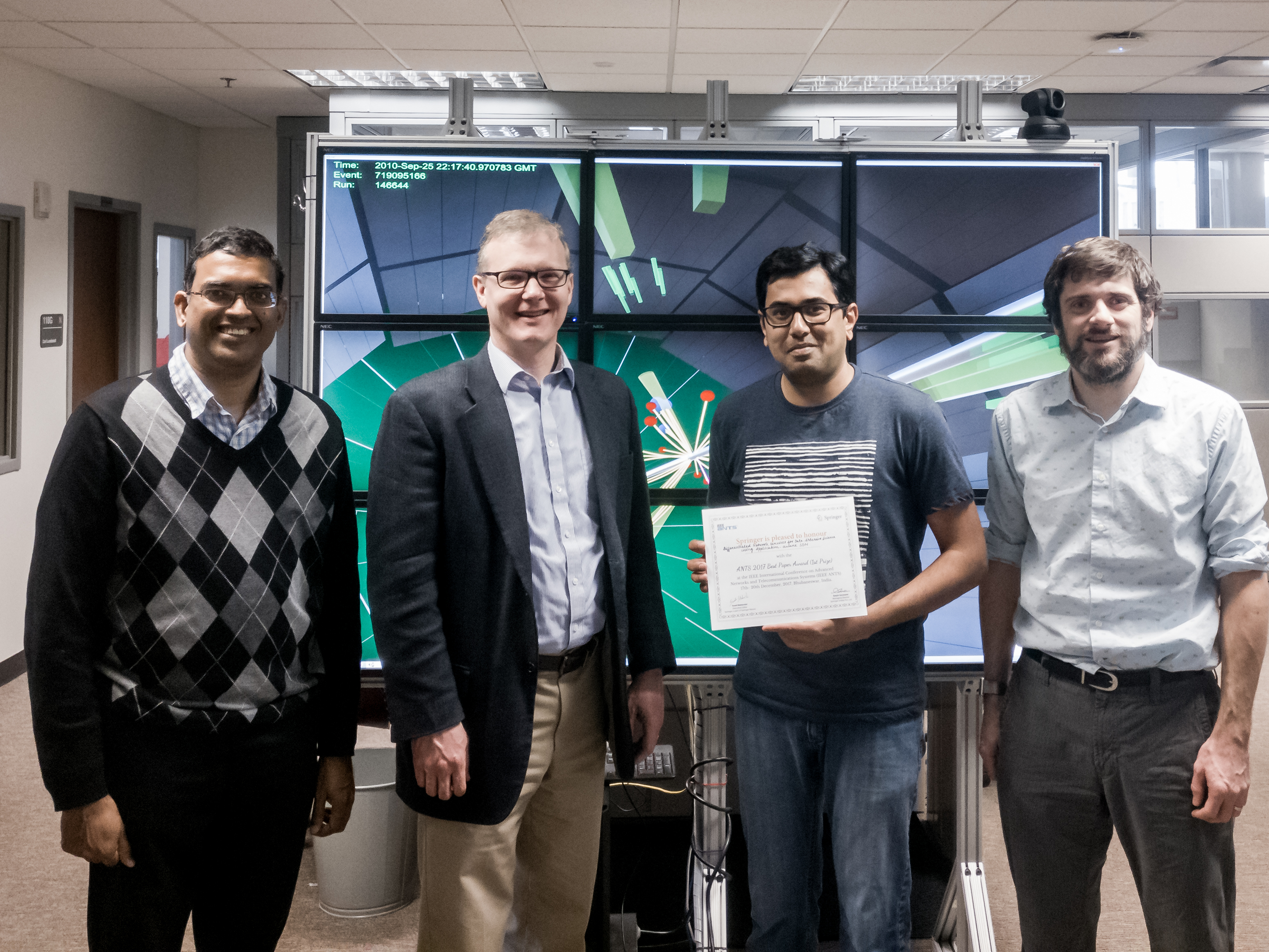From left to right: Byrav Ramamurthy, David Swanson, Deepak Nadig Anantha, and Brian Bockelman.