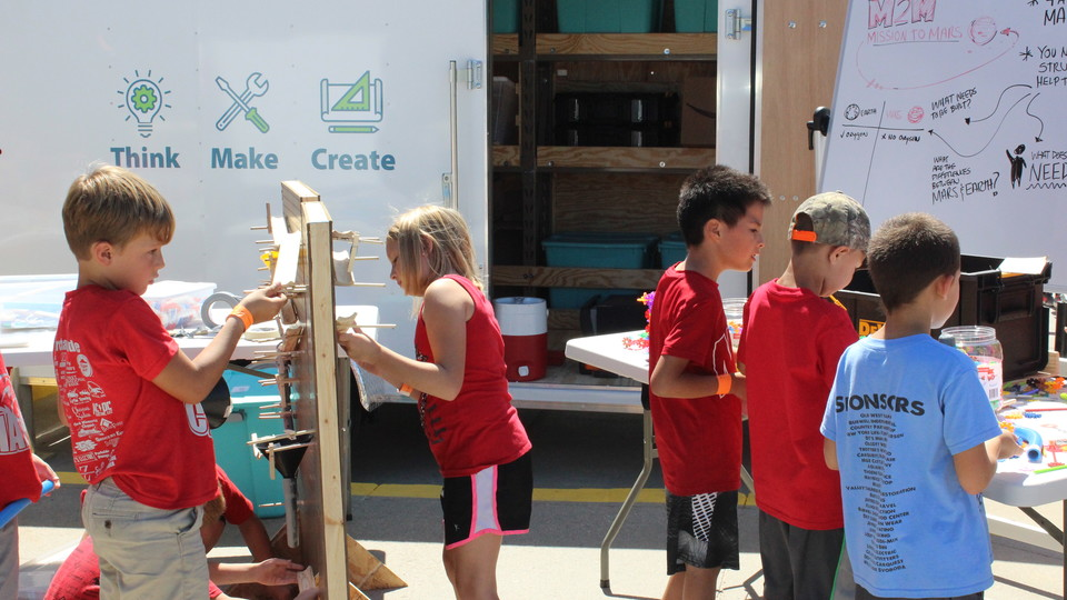 Elementary and middle school students participate in activities offered at the Think Make Create Lab during the 2017 Nebraska State Fair in Grand Island. The mobile maker spaces are funded by Beyond School Bells, which is partnering with Nebraska Innovati
