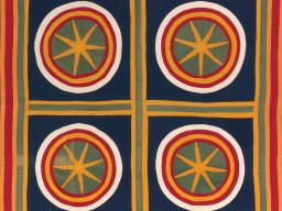 This Sand Dollars quilt, created by an unknown American maker circa 1880-1900, is one of 28 quilts from Ken Burns's private quilt collection appearing at the International Quilt Study Center & Museum.