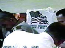 """A still from Jenny Polak and Dread Scott's 2004 video collaboration """"Welcome to America,"""" which explores brutality against immigrants in U.S. detention after Sept. 11, 2001."""