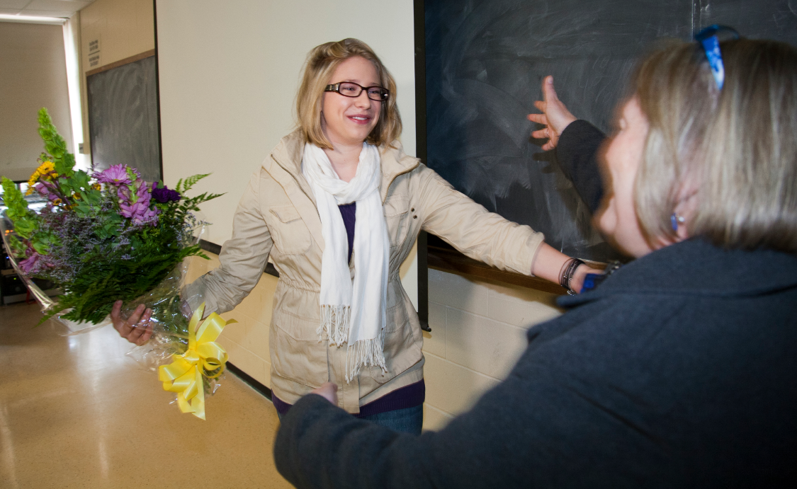 Emily Schlichting (left) moves to hug Laura Damuth, director of undergraduate research and fellowship adviser, during the March 30 Truman Scholarship announcement.