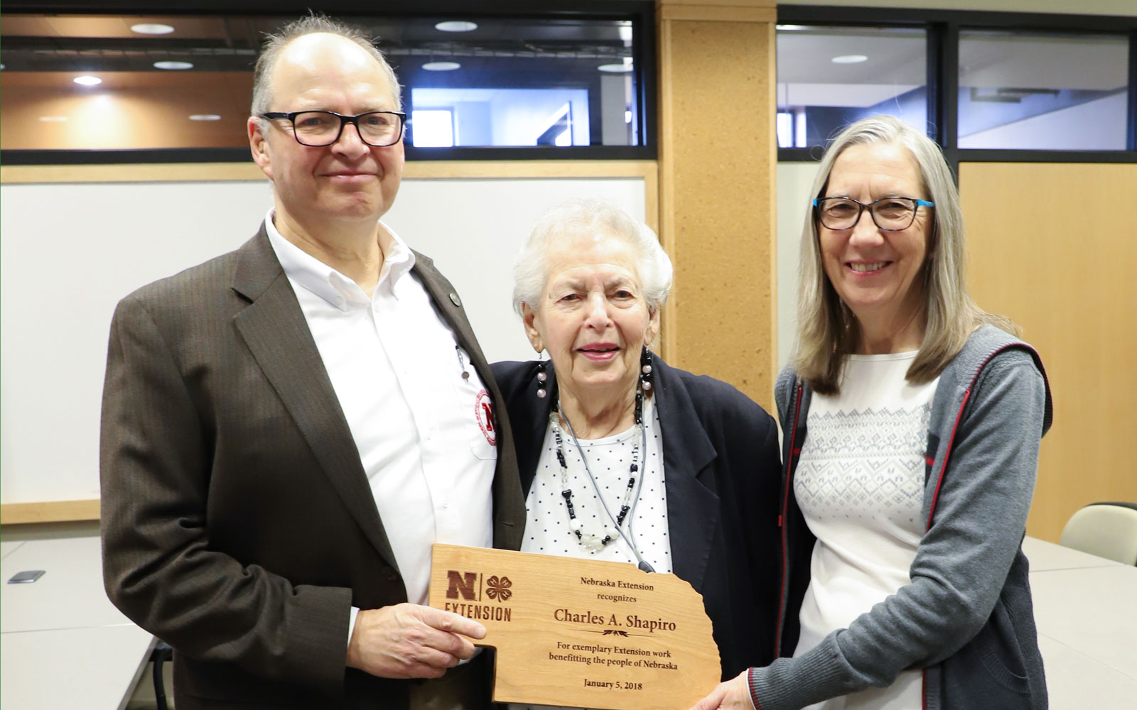 Charles Shapiro, from left, with his mother Edith Shapiro and wife Joan Sudmann Shapiro celebrate at the Department of Agronomy and Horticulture retirement reception held in his honor.