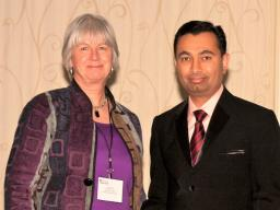 Amit Jhala (right) receives the Outstanding Reviewer Award at the 58th Annual Conference of the Weed Science Society of America. Pictured with Jhala is Sara Ward, director of publication, Weed Science Society of America.