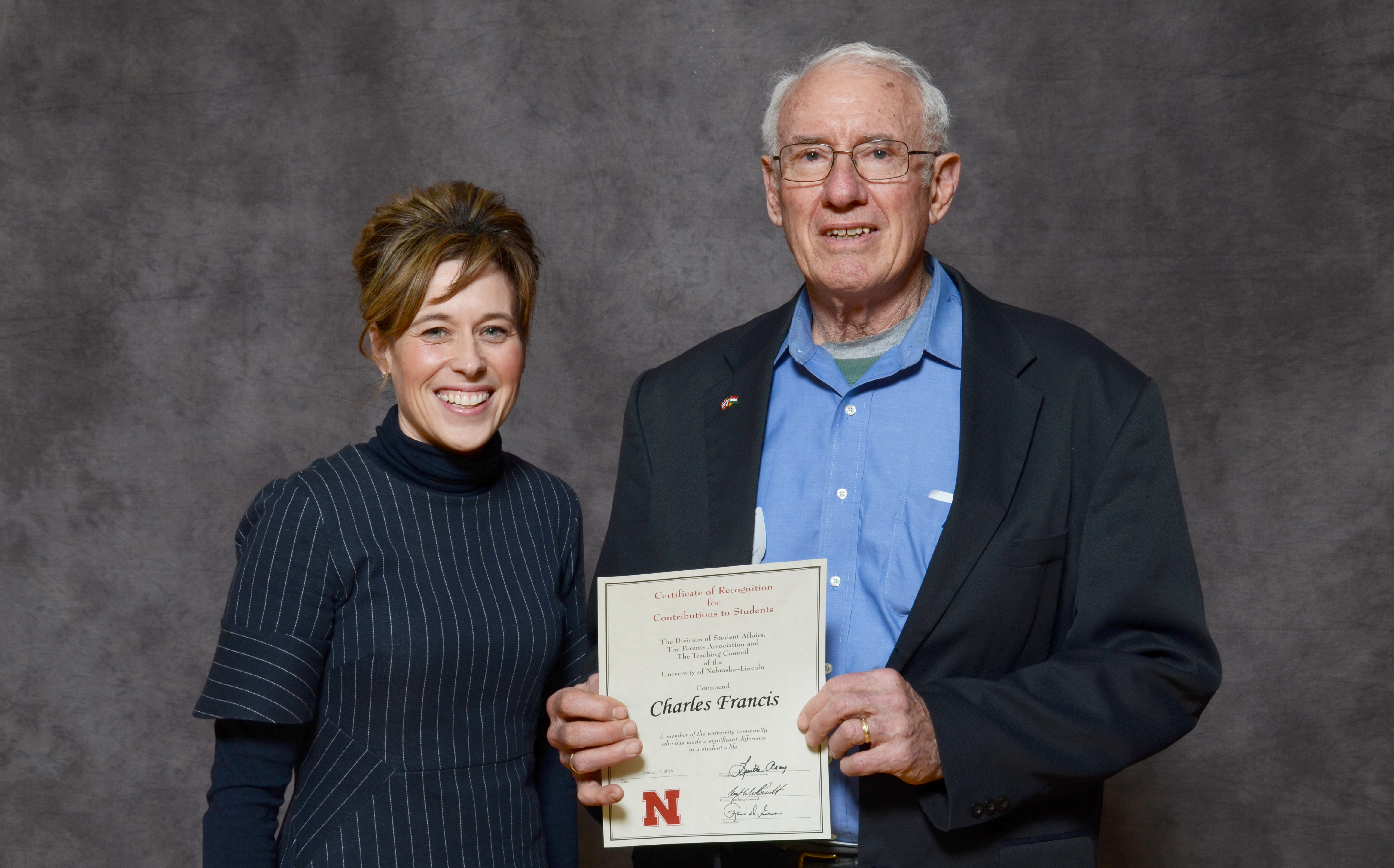 Charles Francis, right, accepts his Parents' Recognition Award from Tiffany Heng-Moss, dean of CASNR, during the Parents' Recognition Awards on Feb. 2. Five agronomy and horticulture faculty members were honored for their support of Nebraska students.