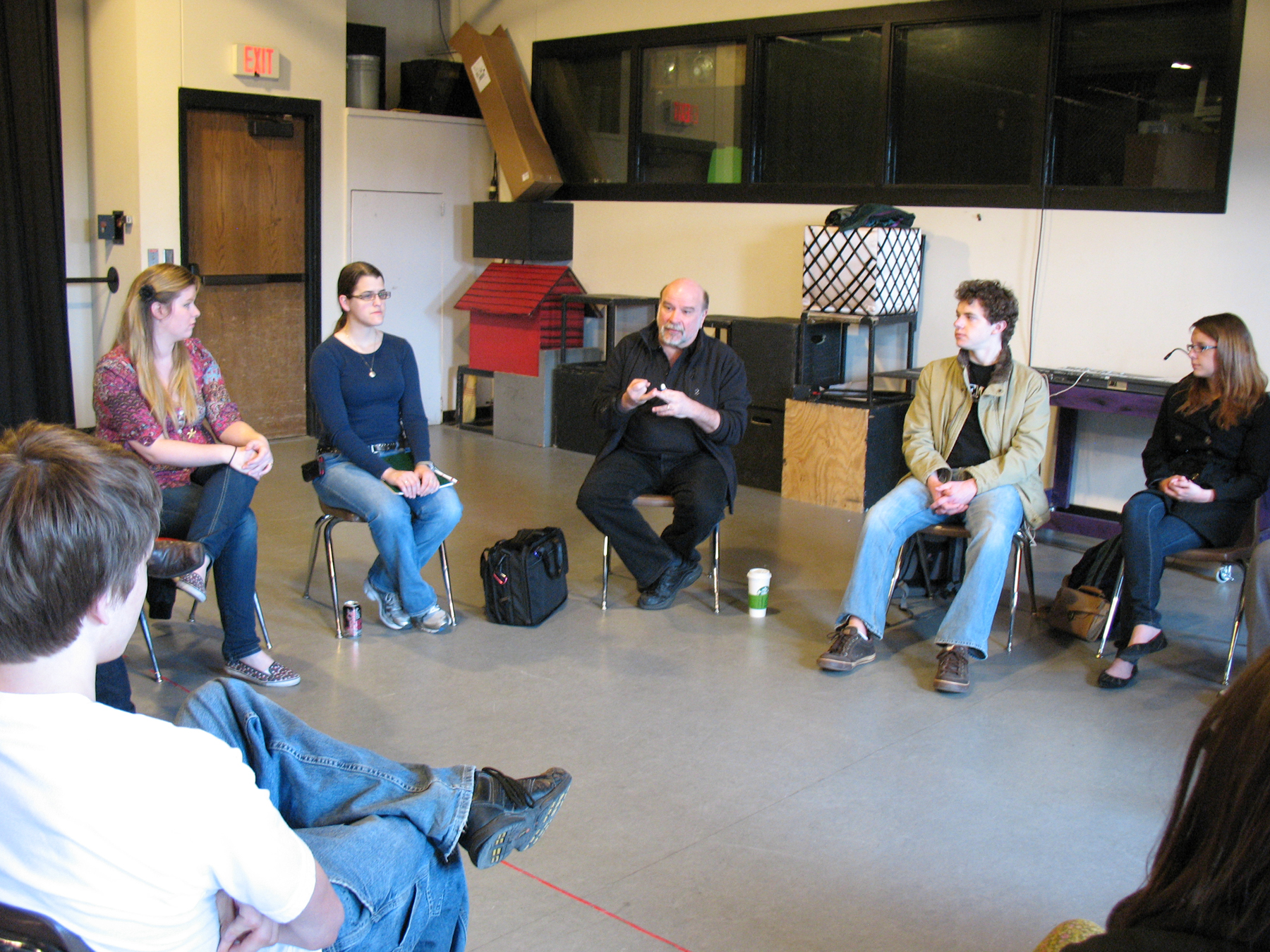 Steve Shelley (center) visits with students in a lighting design class on April 4.