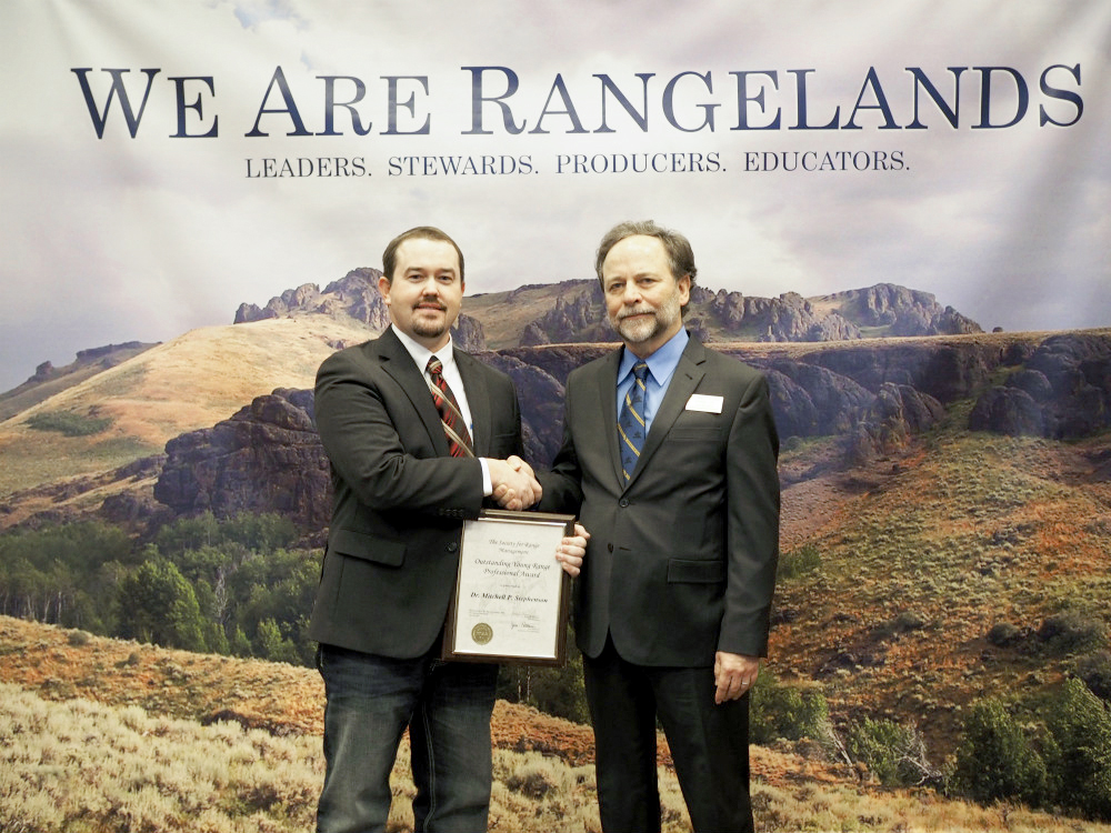 Mitchell Stephenson, left, receives the 2018 SRM Outstanding Young Range Professional Award from SRM 2017 President Larry Howery. Courtesy Photo